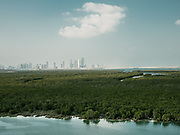 View towards Abu Dhabi skyline from the Mangrove National Park, one of the Emirate's most important ecological asset.