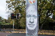 Paste up political street art of Prime Minister Boris Johnson with his eyes scratched out, made up of expletive language, posted on a lamp post on 24th October 2020 in Birmingham, United Kingdom.