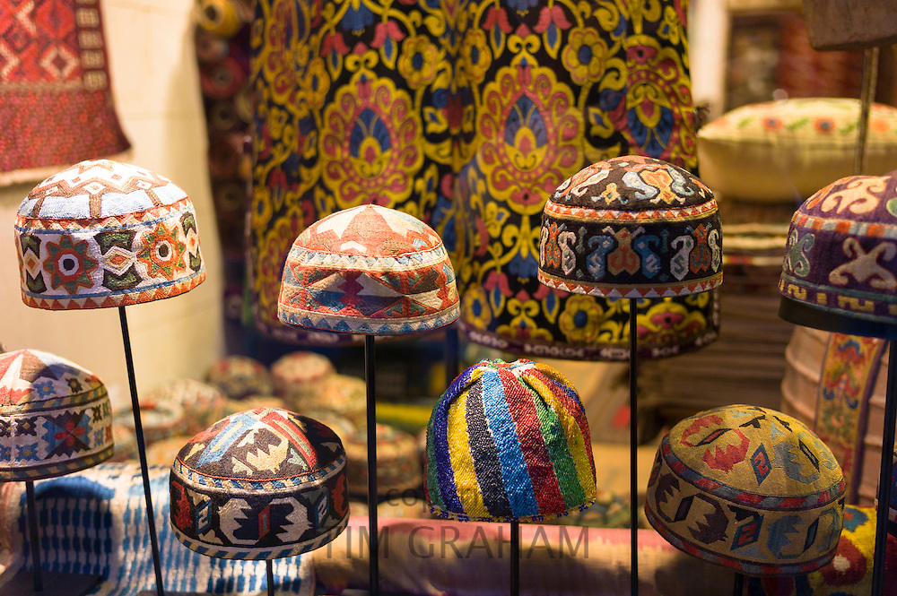 Turkish Muslim prayer caps kufi prayer skullcap or taqiyah (tagiya) in shop window in Istanbul, Republic of Turkey