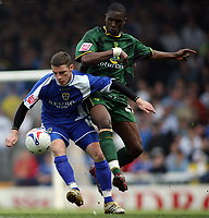 Jason Koumas of Cardiff City tries to hold off the challenge of Norwich player Dickson Etuhu
