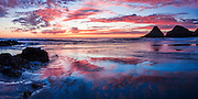 Reflections on the beach at sunset on the Oregon Coast