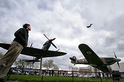 © Licensed to London News Pictures. 17/05/2013 London, UK. A visitor watches the last remaining flying Lancaster bomber pay tribute to the Dambusters on a flypast at the RAF Museum, London. Nineteen of the classic aircraft took part in the historic raid on German dam's 70 years ago. .Photo credit : Simon Jacobs/LNP
