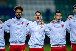 TALLINN, ESTONIA - Monday, October 11, 2021: Wales' (L-R) Sorba Thomas, Harry Wilson and Connor Roberts sing the national anthem before the FIFA World Cup Qatar 2022 Qualifying Group E match between Estonia and Wales at the A. Le Coq Arena. Wales won 1-0. (Pic by David Rawcliffe/Propaganda)