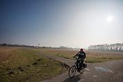 In Lelystad rijdt een man op de fiets.<br /> <br /> A man is cycling in Lelystad.