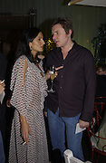 Yasmin Mills and Simon le Bon. An evening at Sanderson in aid of Sargent Cancer Care for children. Sanderson Hotel. 28 May 2002. © Copyright Photograph by Dafydd Jones 66 Stockwell Park Rd. London SW9 0DA Tel 020 7733 0108 www.dafjones.com