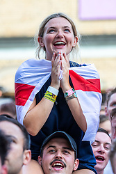 © Licensed to London News Pictures. 07/07/2018. London, UK. England fans react as they watch England v Sweden in the World Cup Quarter Final as it is shown on the big screen at Flat Iron Square in London. Photo credit: Rob Pinney/LNP