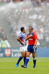 Referee John Lacey (IRE) looks on as the sprinklers are accidentaly set off during the match - Mandatory byline: Rogan Thomson/JMP - 07966 386802 - 29/08/2015 - RUGBY UNION - The Stadium at Queen Elizabeth Olympic Park - London, England - Barbarians v Samoa - International Friendly.