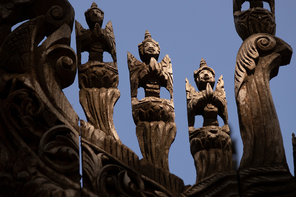 Wooden carved figures at the Shwenandaw Golden Palace Monastery. Built in 1880 of carved teak, Shwenandaw Monastery was originally part of the imperial palace at Amarapura