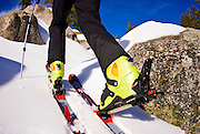 Backcountry skier climbing with skins on Panther Peak, Sequoia National Park, California