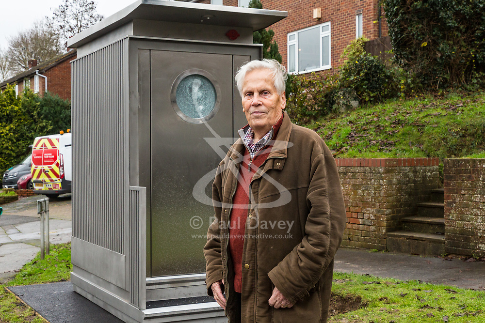 Local Bromley and Borough Councillor Julian Benington of the Biggin Hill Ward surveys the scene. Local residents are both mystified and annoyed about the sudden appearance of a toilet for bus drivers that has been erected on the corner of Melody Road and Whitby Close in Biggin Hill, Kent. Biggin Hill, Kent, December 06 2018.
