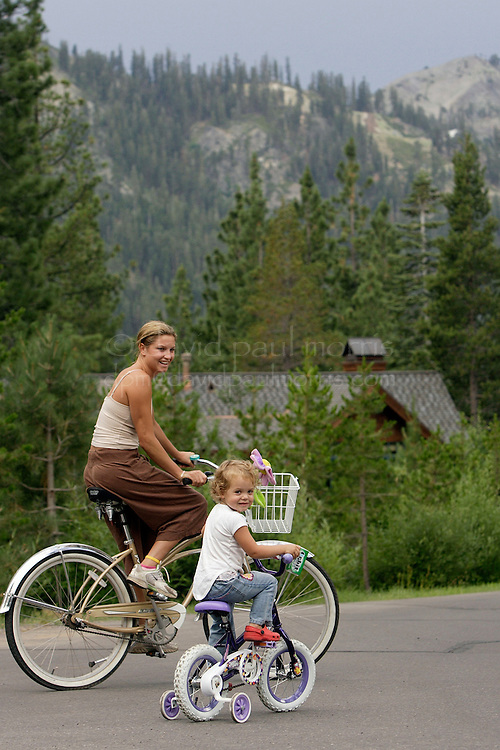 SQUAW VALLEY,  CA -  JULY 21:  2006 Olympic Gold Medal winner in the Womans Giant Slalom, Julia Mancuso, 22 rides her bike with her sister Taly, 3 near their home on July 21, 2006 in Squaw Valley  California. Photo by David Paul Morris