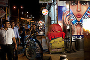 Indian men are walking next to provoking Pepsi advertisement starring Bollywood celebrity Priyanka Chopra, on the streets of Lucknow, the state capital of Uttar Pradesh, India.