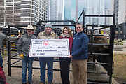 Professional Bull Riding makes a donation to Special Olympics during a presentation with Professional Bull Riding (PBR) 2020 Tour and Special Olympics Illinois (SOILL) in Chicago, Friday, Jan. 10, 2020, in Chicago in Maggie Daley Park. Matt West, Joe Renner, Kate Risley, and Chris Winston pose with the $5,000 check.  (Max Siker/Image of Sport via AP)