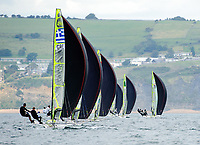 Fleet downwind with spinnakers set, Sailing Olympic Test Event, 49er men's skiff Class, Weymouth