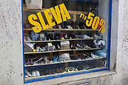 The window of a shoe discount business, on Milady Horakove, Holesovice district, Prague 7, on 18th March, 2018, in Prague, the Czech Republic.
