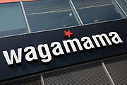 Sign for the food and restaurant brand Wagamama in Birmingham, United Kingdom.