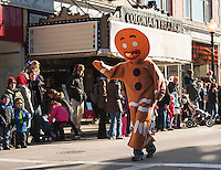 "The ""Gingerbread Man"" waves to the crowd lining Main Street Laconia's annual Holiday Parade downtown Saturday morning.  (Karen Bobotas/for the Laconia Daily Sun)"