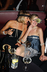 Left to right, LADY EMILY COMPTON and LADY ELOISE ANSON at Andy & Patti Wong's Chinese New Year party to celebrate the year of the Rooster held at the Great Eastern Hotel, Liverpool Street, London on 29th January 2005.  Guests were invited to dress in 1920's Shanghai fashion.<br />