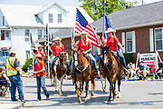 The Benton Rodeo Chicks ride in the Independence Day parade in Millville, Pennsylvania on July 5, 2021.