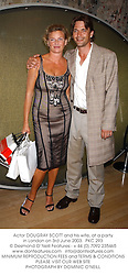 Actor DOUGRAY SCOTT and his wife, at a party in London on 3rd June 2003.  PKC 293