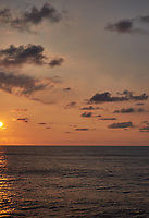 Orange colored sky and clouds over the Pacific Ocean just after sunrise. Image 9 of 10 for a wide-angle panorama taken with a Fuji X-T1 camera and 35 mm f/1.4 lens  (ISO 200, 35 mm, f/16, 1/250 sec). Raw images processed with Capture One Pro and stitched together with AutoPano Giga Pro.
