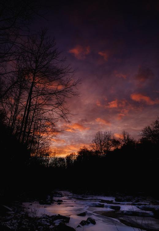 Sunset on the frozen Patapsco at Oella, Maryland.