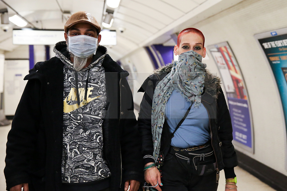 © Licensed to London News Pictures. 17/03/2020. London, UK. Commuters wearing face masks at Kings Cross underground station. London Transport will reduce weekday services during the coronavirus crisis to a weekend level of service. Photo credit: Dinendra Haria/LNP