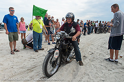Sante Mazza riding his 1926 Moto Frera passes through the start on the sands of Daytona Beach at the beginning of stage 1 of the Motorcycle Cannonball Cross-Country Endurance Run, which on this day ran from Daytona Beach to Lake City, FL., USA. Friday, September 5, 2014.  Photography ©2014 Michael Lichter.