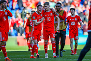 Wales players celebrate at full time during the UEFA European 2020 Qualifier match between Wales and Slovakia at the Cardiff City Stadium, Cardiff, Wales on 24 March 2019.