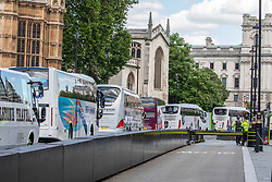 © Licensed to London News Pictures. 20/07/2020. London, UK. A demonstration by 500 coaches took place in Westminster including driving around Parliament Square asking government for more help for the coach industry. Last week, Prime Minister Boris Johnson urged Britons to return back to working in offices to help service industries and the economic recovery. Photo credit: Alex Lentati/LNP