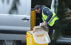 A courier prepares to deliver some Amazon packages from his van in London. Issue date: Thursday April 2, 2020.