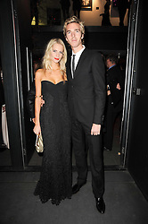 POPPY DELEVINGNE and JAMES COOK at The Love Ball hosted by Natalia Vodianova and Lucy Yeomans to raise funds for The Naked Heart Foundation held at The Round House, Chalk Farm, London on 23rd February 2010.