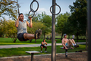Brendon Lemon works out Wednesday, Sept. 16, 2020 at the outdoor fitness equipment area near Wellington Avenue in Lincoln Park. (Brian Cassella/Chicago Tribune)
