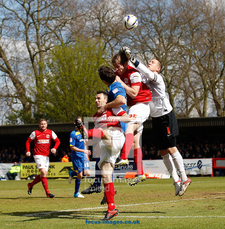 Picture by Andrew Tobin/Focus Images Ltd +44 7710 761829.27/04/2013. Scott Davies of Fleetwood Town punches clear during the npower League 2 match at the Cherry Red Records Stadium, Kingston.