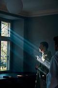 Daniel Nørgaard performs a personal prayer before mass at Sankt Ansgars in Copenhagen, Denmark.