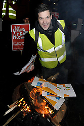 © Licensed to London News Pictures. 13/12/2012.Protesters stage a demonstration, candle light vigil and the burning of the consultation paper outside  Lewisham Hospital tonight (13.12.12) to mark the final day of the consultation period to close the hospital.   The event is  organised by Save Lewisham Hospital Campaign  demonstrators. .Photo credit : Grant Falvey/LNP