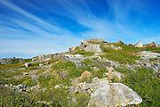 Rocky, barren landscape and clouds<br />Iles aux Morts<br />Newfoundland & Labrador<br />Canada