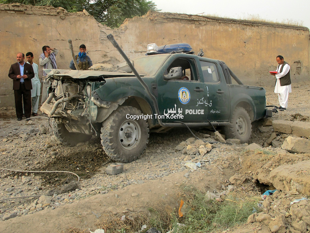 Afghan police car drove on a IED in Afghanistan