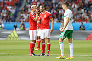Aaron Ramsey of Wales (l) whispers and talks tactics with Gareth Bale of Wales (no11).UEFA Euro 2016, last 16 , Wales v Northern Ireland at the Parc des Princes in Paris, France on Saturday 25th June 2016, pic by  Andrew Orchard, Andrew Orchard sports photography.