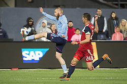 April 29, 2018 - Bronx, New York, United States - New York City forward JO INGE BERGET (9) brings down a pass defended by FC Dallas defender MATT HEDGES (24) during a regular season match at Yankee Stadium in Bronx, NY.  NYCFC defeats FC Dallas 3 to 1. (Credit Image: © Mark Smith via ZUMA Wire)