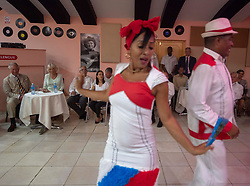 The Prince of Wales and the Duchess of Cornwall sees a couple dancing during a visit to the Areito EGREM Recording Studios, in Havana, Cuba, as part of an historic trip which celebrates cultural ties between the UK and the Communist state.