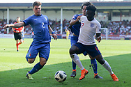 Alberto Barazzetta of Italy (2) tackles Bukayo Saka of England (17) during the UEFA European Under 17 Championship 2018 match between England and Italy at the Banks's Stadium, Walsall, England on 7 May 2018. Picture by Mick Haynes.