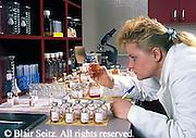 female researcher, lab specimens