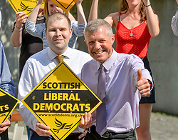 Pictured: council Robert Brown, councillor Mark McGeever and Willie Rennie.<br /> <br /> South Lanarkshire Conservative Councillor Mark McGeever has defected to the Scottish Liberal Democrats, following the election of Boris Johnson as the new Conservative leader and Prime Minister. He has represented Hamilton West and Earnock since 2017.<br /> <br /> © Dave Johnston / EEm