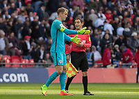 Football - 2016 / 2017 World Cup Qualifier - UEFA Group F: England vs. Lithuania<br /> <br /> Joe Hart of England speaks to the linesman after he believed he was fouled at Wembley.<br /> <br /> COLORSPORT/DANIEL BEARHAM