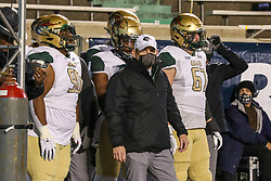 Dec 18, 2020; Huntington, West Virginia, USA; UAB Blazers head coach Bill Clark leads his team onto the field before their game against the Marshall Thundering Herd at Joan C. Edwards Stadium. Mandatory Credit: Ben Queen-USA TODAY Sports