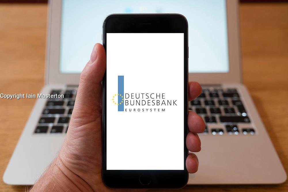 Using iPhone smart phone to display website logo of Deutsche Bundesbank, central Bank of Germany