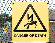 Close up sign Danger of Death at electricity sub station, Knodishall, Suffolk, England, UK