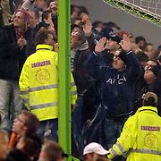 NLD/Arnhem/20051211 - Voetbal, Vitesse - Ajax 2005, Ajax supporters achter de plastic schotten in hun vak