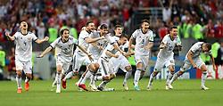 Russia's Sergei Ignashevich, Mario Fernandes, Vladimir Granat, Aleksandr Yerokhin, Aleksandr Golovin, Fyodor Kudryashov, Roman Zobnin, Ilya Kutepov, Fyodor Smolov and Denis Cheryshev celebrate defeating Spain 4-3 on penalties